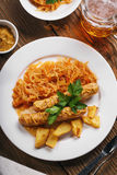 Baked Munich sausages with stewed cabbage and a glass of beer.  royalty free stock photo