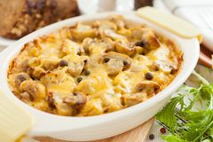 Baked mushrooms, potatoes and cheese closeup Royalty Free Stock Image