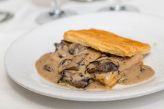 Baked Mushrooms in Puff Pastry. Fresh baked puff pastry with rich mushroom gravy inside stock images