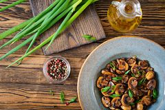 Baked mushrooms with soy sauce and herbs. Vegan food. Top view stock photo