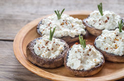 Baked mushrooms stuffed with cream cheese Stock Photos