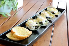 Baked mussel with cheese Stock Image