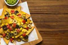 Baked Nachos with Cheese and Vegetables Stock Photo