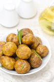 Baked new potatoes with spices and rosemary in a bowl Royalty Free Stock Image