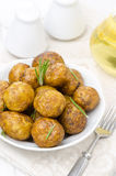 Baked new potatoes with spices and rosemary Stock Photos