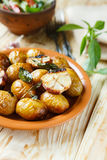 Baked new potatoes in their skins and garlic Stock Image