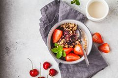 Baked oatmeal with berries and milk in a gray bowl, top view. Vegan breakfast. Baked oatmeal with berries and milk in a gray bowl. Vegan breakfast royalty free stock photo