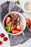 Baked oatmeal with berries and milk in a gray bowl, top view. Vegan breakfast. Baked oatmeal with berries and milk in a gray bowl. Vegan breakfast royalty free stock images