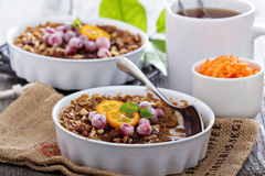 Baked oatmeal with carrot, walnuts and raisins Royalty Free Stock Images