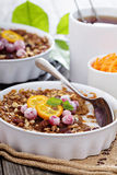 Baked oatmeal with carrot, walnuts and raisins Stock Image