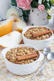 Baked oatmeal with nuts, almond milk, spices and asian pear Stock Image