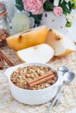 Baked oatmeal with nuts, almond milk, spices and asian pear Stock Photos