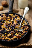Baked Oatmeal in a pig-iron frying pan. Style rustic. selective focus stock images