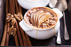 Baked oatmeal with spices and pears. In small baking dish Stock Photo