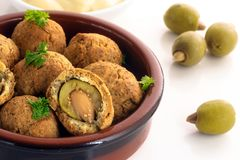 Baked olives in a dough coat with parmesan cheese, party finger Stock Photography