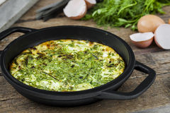Baked omelet with zucchini and herbs Stock Image