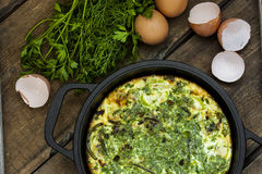 Baked omelet with zucchini and herbs Stock Images