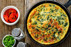 Baked omelette with spinach, dill, parsley and green onions Stock Photo