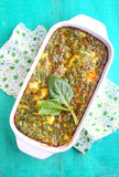Baked omelette with spinach. In a white rectangular shape stock photos