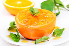 Baked orange decorated mint, close up view Royalty Free Stock Photography