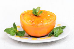 Baked orange decorated mint Stock Photo