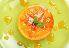 Baked orange fruit decorated mint Royalty Free Stock Photos