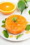 Baked orange fruit decorated mint Royalty Free Stock Photography