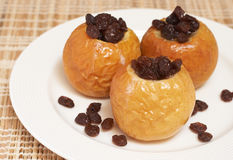 Baked organic apples. Delicious dessert of freshly baked organic apples with raisins Stock Photo