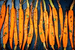 Baked organic carrots with thyme Royalty Free Stock Photo