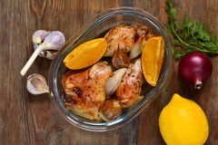 Baked in the oven chicken with orange, garlic and onion Stock Images