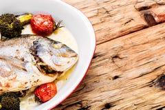 Baked in oven sea fish dorado stock photos