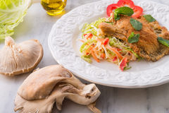 Baked oyster mushrooms with fresh savoy cabbage salad Royalty Free Stock Images