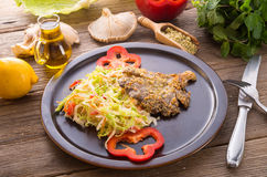 Baked oyster mushrooms with fresh savoy cabbage salad Royalty Free Stock Photo
