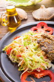 Baked oyster mushrooms with fresh savoy cabbage salad Royalty Free Stock Image