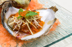 Baked oyster shell spicy sauce. Stock Photo