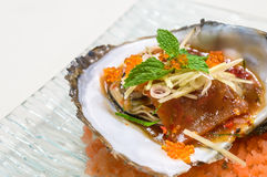 Baked oyster shell spicy sauce. Royalty Free Stock Photos