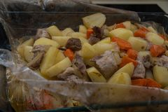 Baked in the package turkey meat with potatoes and carrots Royalty Free Stock Photography