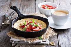 Baked pancake in cast iron pan Stock Images