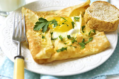 Baked pancake with egg,ham and cheese. Stock Image