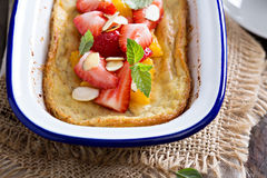 Baked pancake with oranges and strawberries Royalty Free Stock Images