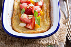 Baked pancake with oranges and strawberries Royalty Free Stock Photo
