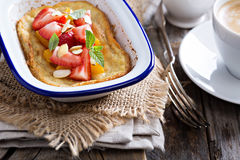 Baked pancake with oranges and strawberries Royalty Free Stock Image