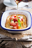Baked pancake with oranges and strawberries Stock Photography
