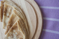 Baked pancakes on lilac tablecloth Royalty Free Stock Photography