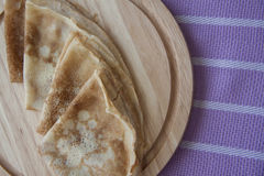 Baked pancakes on lilac tablecloth Royalty Free Stock Images