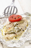 Baked pangasius in tin foil. Baked pangasius with pepper and tomato in tin foil Stock Photo