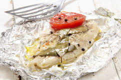 Baked pangasius in tin foil. Baked pangasius with pepper and tomato in tin foil Royalty Free Stock Photography