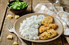 Baked Parmesan Parsley Crusted Chicken with rice Stock Photos