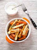 Baked parsnips and carrots in bowl Stock Images