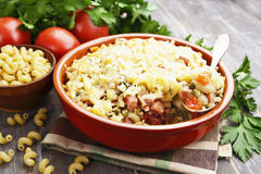 Baked pasta with bacon and green peas Stock Images